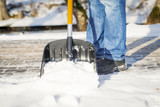 Fototapety Man with a snow shovel on the sidewalk
