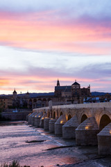 Mezquita and roman bridge at evening, Spain