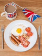 Full english breakfast with cup of tea and british flag