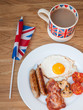 Bacon and eggs with cup of tea and british flag