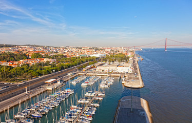 top view on yachts and the bridge 25 Arpels in Lisbon, Portugal