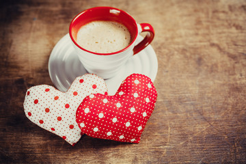 Cup of coffee and heart on wooden background. Valentine's day.