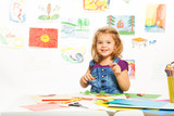 Smiling girl busy gluing poster