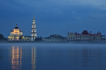Skyline of Rybinsk embankment with evening fog