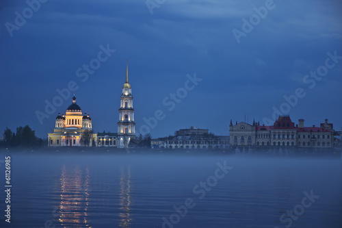 Skyline of Rybinsk Volga embankment with evening fog