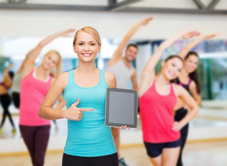 sporty woman with tablet pc blank screen