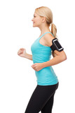sporty woman running with smartphone