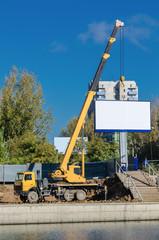 crane and billboard