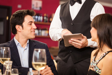 Waiter using a digital tablet
