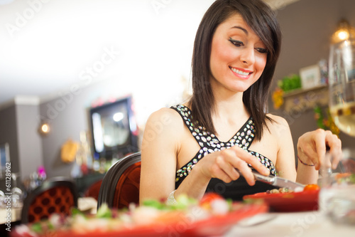 Woman having dinner