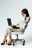 businesswoman using laptop and talking on the phone