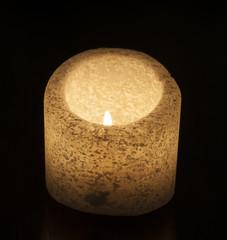Ornate salt candle on black background