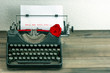 vintage typewriter with love letter and red rose flower