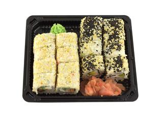 Sushi rolls in black plastic container isolated closeup
