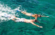 Couple snorkeling in tropics