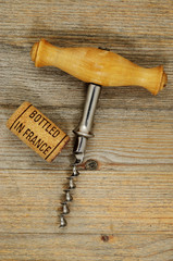 vintage corkscrew and wine cork with inscription bottled in Fran