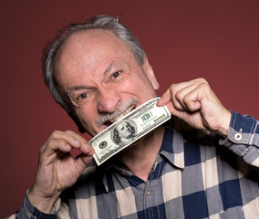 Man holding with pleasure one hundred dollar bill