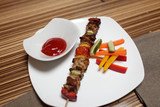 Kebab stick on a plate