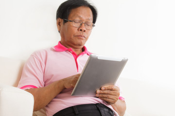 Senior man using digital tablet