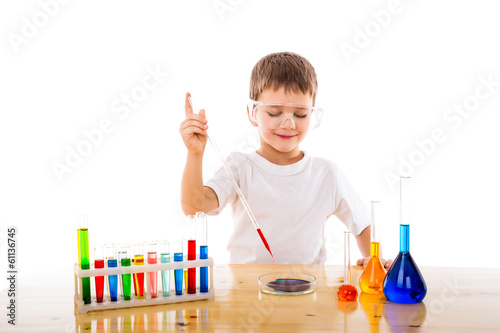 Boy mixes chemicals in the lab