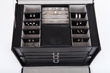 Black leather jewelery box with jewelry inside
