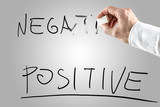 Man erasing Negative over Positive