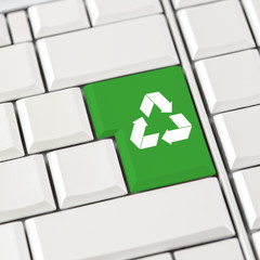 Green recycle icon on a computer keyboard