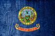 Idaho State Flag painted on luxury crocodile texture