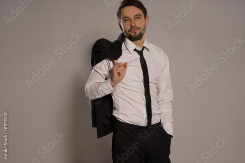 Handsome businessman loosening his tie