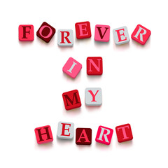 "Words ""forever in my heart"" with colorful blocks"