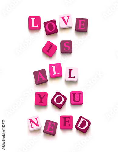 "Words ""love is all you need"" with colorful blocks"