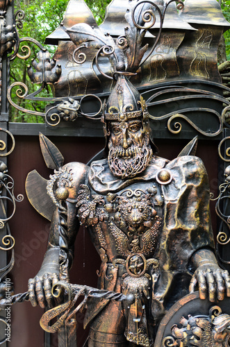 Ornate metal statue of a knight at arms