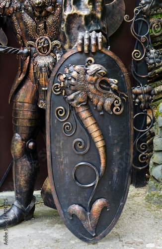 Ornate shield of a bronze statue