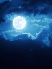 Dramatic Moonrise With Deep Blue Nightime Sky and Clouds
