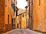 Rustic medieval street in a town in Tuscany, Italy - 61143318