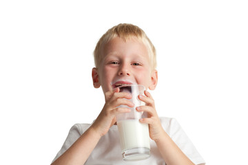 Little boy drinking milk.
