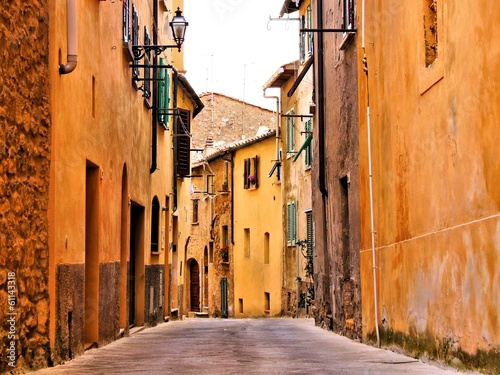 Rustic medieval street in a town in Tuscany, Italy
