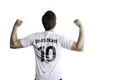 German soccer player celebrates on white background