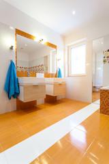 Big white and orange bathroom