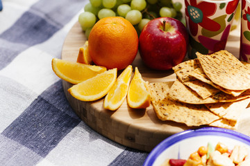 fresh fruit and snacks on picnic blanket