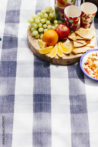 picnic setting with fresh fruit and snacks