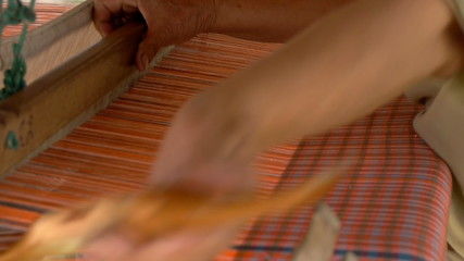 Weaver working on the loom