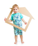 Adorable boy in own cardboard home or room concept