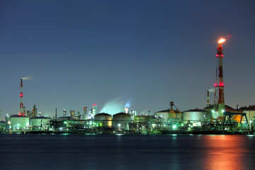 Industrial building and seascape at night