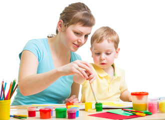 mother and son drawing or painting together isolated on white