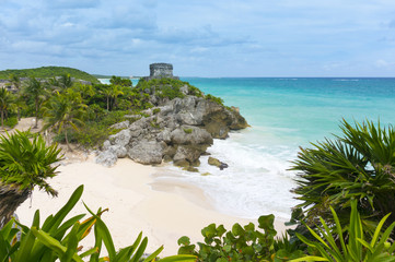 Beautiful empty Caribbean beach in Tulum with ancient temple