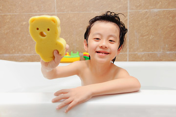 Cute Asian boy having bath