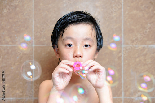 Young boy having fun with bubbles