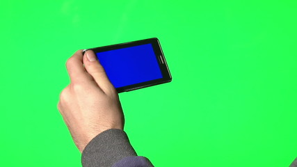 Man using smartphone with a blue screen