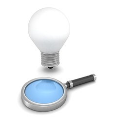 Magnifying glass and concept idea light bulb on white background